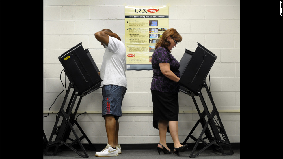 Jack Bunn, 51, and Jane Cookson, 57, cast their votes at the Board of Elections early voting station in Wilson, North Carolina, on Thursday.