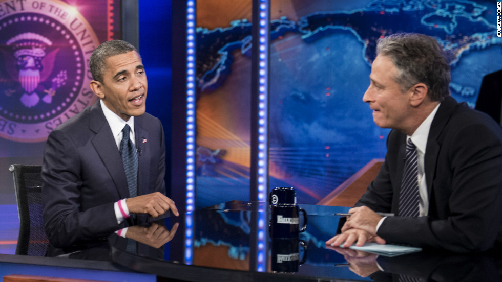 "Barack Obama and Jon Stewart speak during a break in the live taping of Comedy Central's ""The Daily Show with Jon Stewart"" on Thursday."