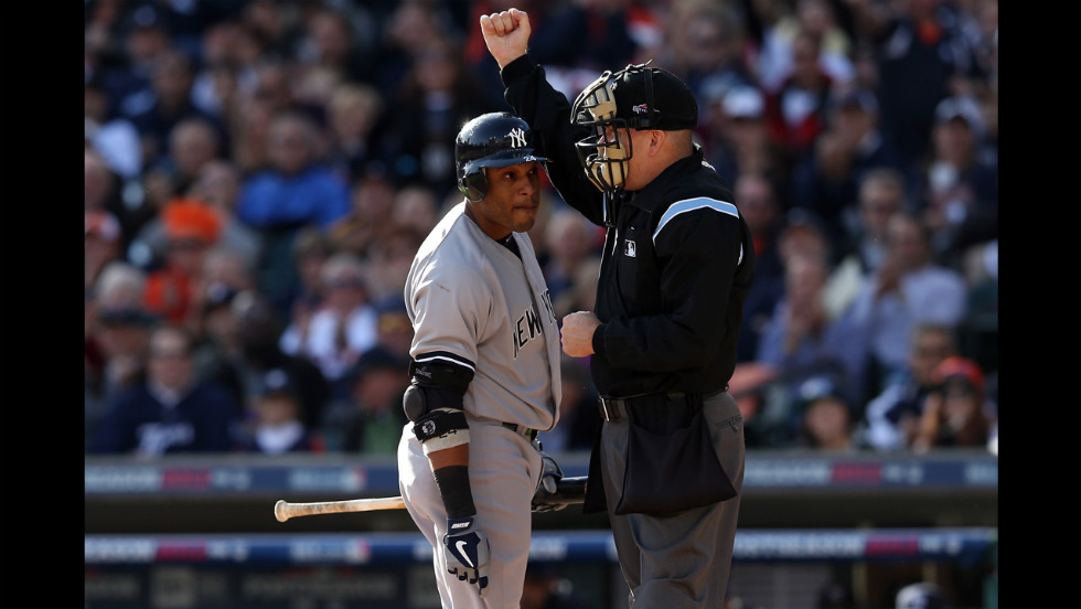 Robinson Cano of the Yankees arguees with home plate umpire Jeff Nelson after striking out in the first inning.