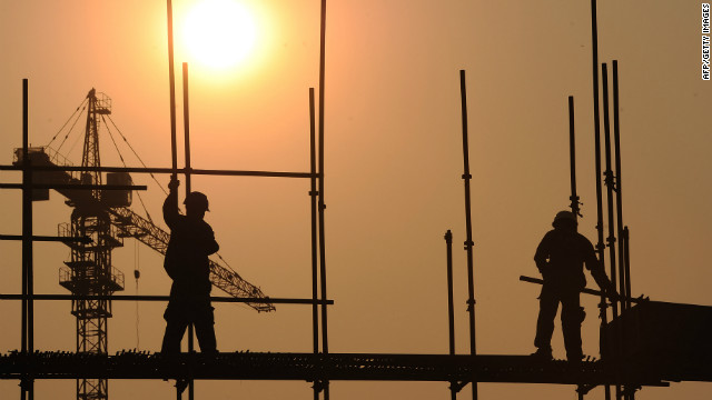 This picture taken on September 26, 2012 shows workers on a scaffold at a construction site in Hefei, central China's Anhui province. China has approved a massive infrastructure package worth more than 158 billion USD, state media said on September 7, as the government seeks to boost the flagging economy.