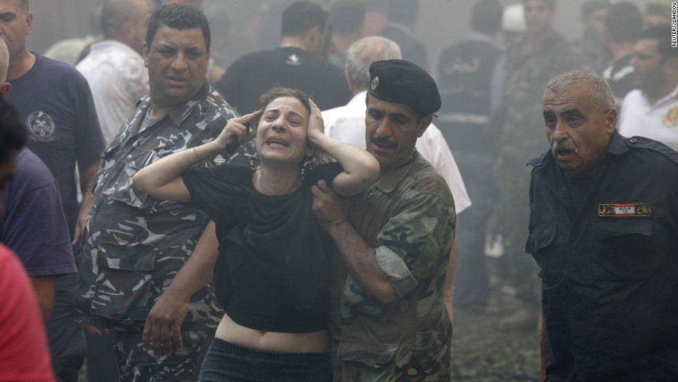 A woman is helped by a Lebanese soldier after the explosion.