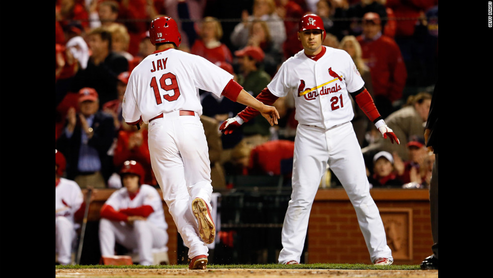 "JJon Jay  and  Allen Craig of the St. Louis Cardinals celebrate after Jay scores on a single by Matt Holliday in the first inning against the San Francisco Giants in Game 4 of the National League Championship Series at Busch Stadium on October 18, in St Louis, Missouri. <a href=""http://www.cnn.com/2012/10/17/worldsport/gallery/nlcs-game-3/index.html"" target=""_blank"">Look back at Game 2 of the NLCS.</a>"