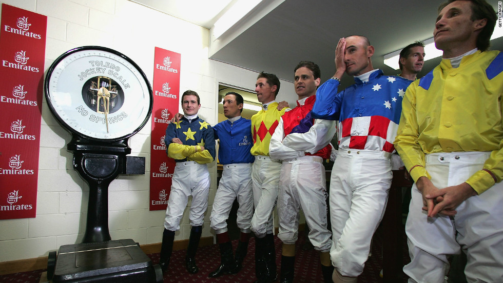 Jockeys line up for weighing ahead of the Melbourne Cup.