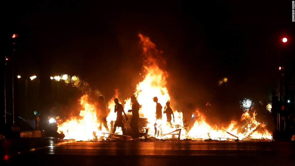 Lebanese men block a road leading to the airport in Beirut to protest against the assassination of top intelligence official Wissam al-Hassan in a blast on Friday, October 19.