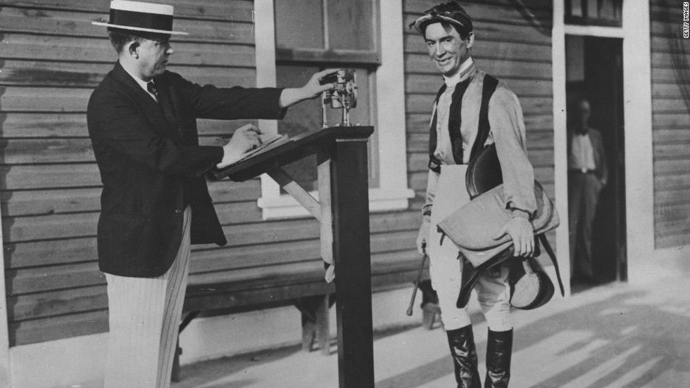 British jockey Steve Donoghue is weighed before a race in 1930.