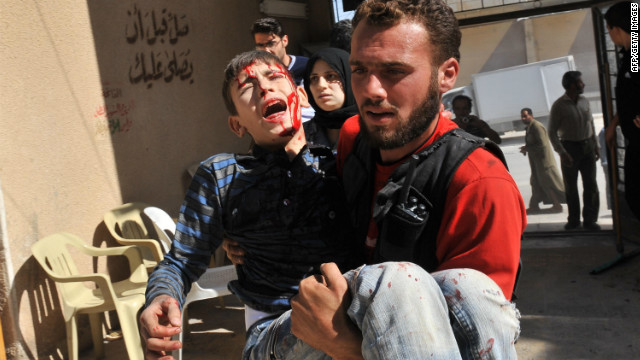 A wounded boy is carried to a hospital after an airstrike by government forces in Maaret al-Numan in Syria on Thursday.