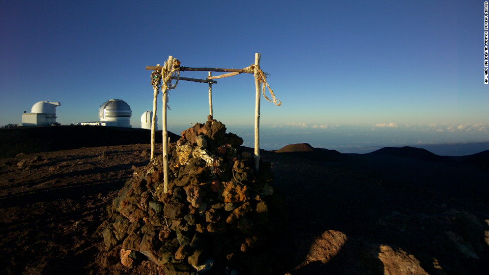 The Mauna Kea summit, 13,796 feet above sea level, gives a dizzyingly high look at the ocean, and island, below.