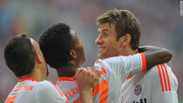 Thomas Mueller (right) celebrates with David Alaba (center) and Franck Ribery as Bayern Munich extended thier winning run.