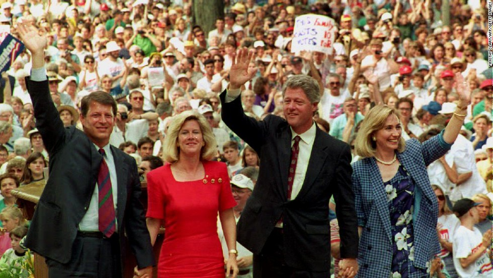 Al Gore, Tipper Gore, Bill Clinton and Hillary Clinton wave to supporters at the Chautauqua Institution in Chautauqua, New York, after they gave speeches on family values on August 23, 1992.