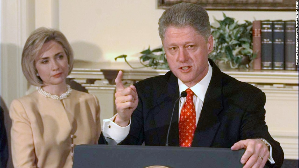 Hillary Clinton looks on as President Clinton discusses the Monica Lewinsky scandal in the Roosevelt Room of the White House on January 26, 1998.