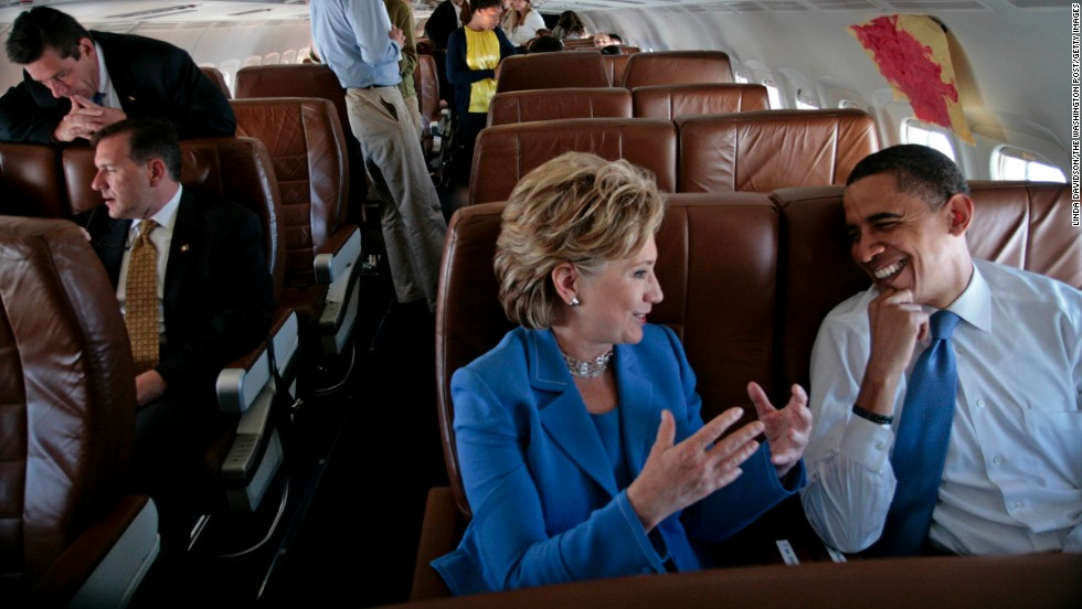 Obama and Clinton talk on the plane on their way to a Unity Rally in Unity, New Hampshire, on June 27, 2008.
