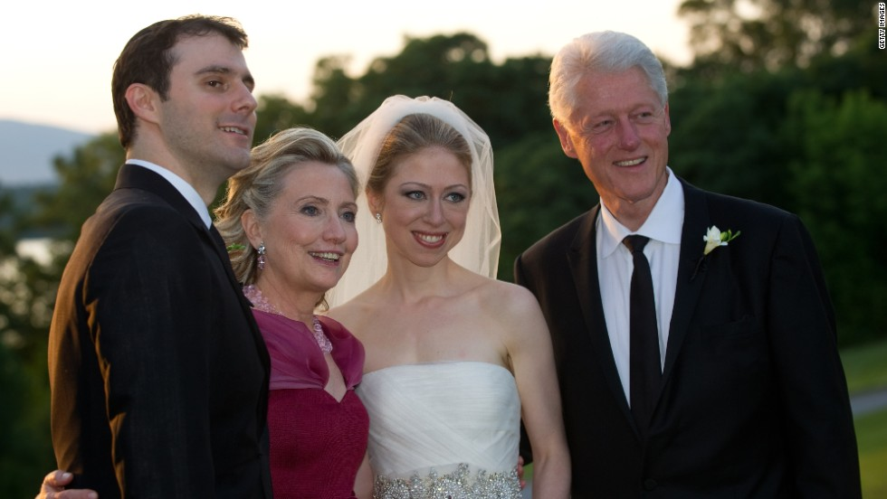Hillary and Bill Clinton pose on the day of their daughter's wedding to Marc Mezvinsky on July 31, 2010, in Rhinebeck, New York.