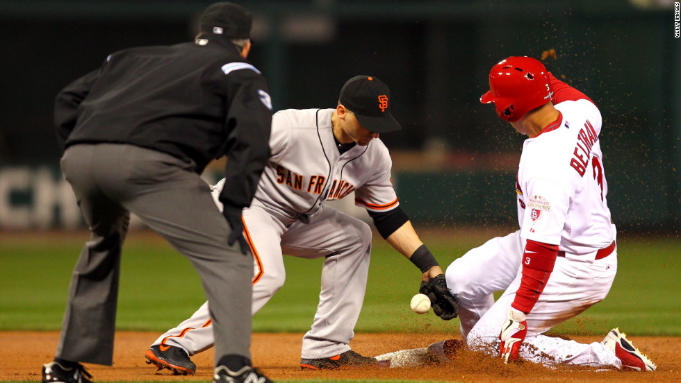 No. 3 Carlos Beltran of the St. Louis Cardinals steals second base covered by No. 19 Marco Scutaro of the San Francisco Giants in the first inning.