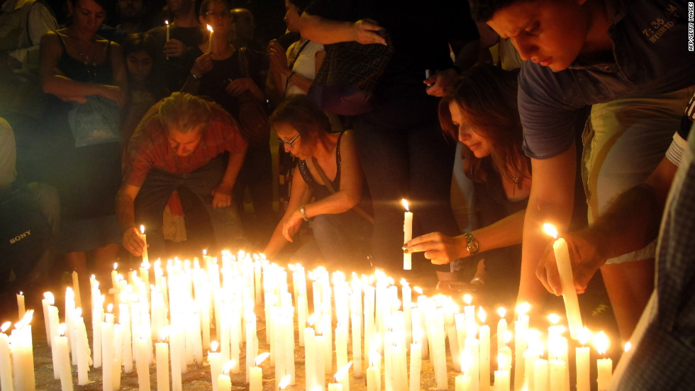 Lebanese light candles during a vigil near the site of the car bomb attack on Saturday.