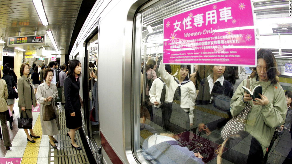"Female passengers board a ""women-only"" carriage at a metro station. Several private railways and subway trains operated by the Tokyo metropolitan government run the carriages during the morning rush hour in order to prevent ""chikan"" (groping) in crowded trains."