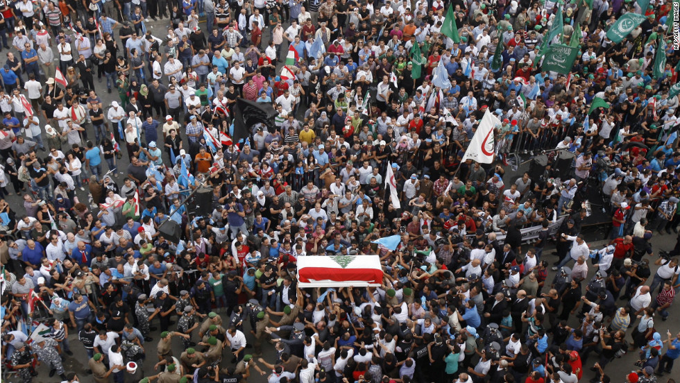 The coffin of intelligence chief Gen. Wissam al-Hassan arrives in downtown Beirut during his funeral procession on Sunday, October 21. Hassan, a prominent Lebanese figure opposed to Syrian President Bashar al-Assad, died when a powerful bomb exploded in an upmarket Beirut suburb on October 19, sparking calls for Prime Minister Najib Mikati and his government to quit.