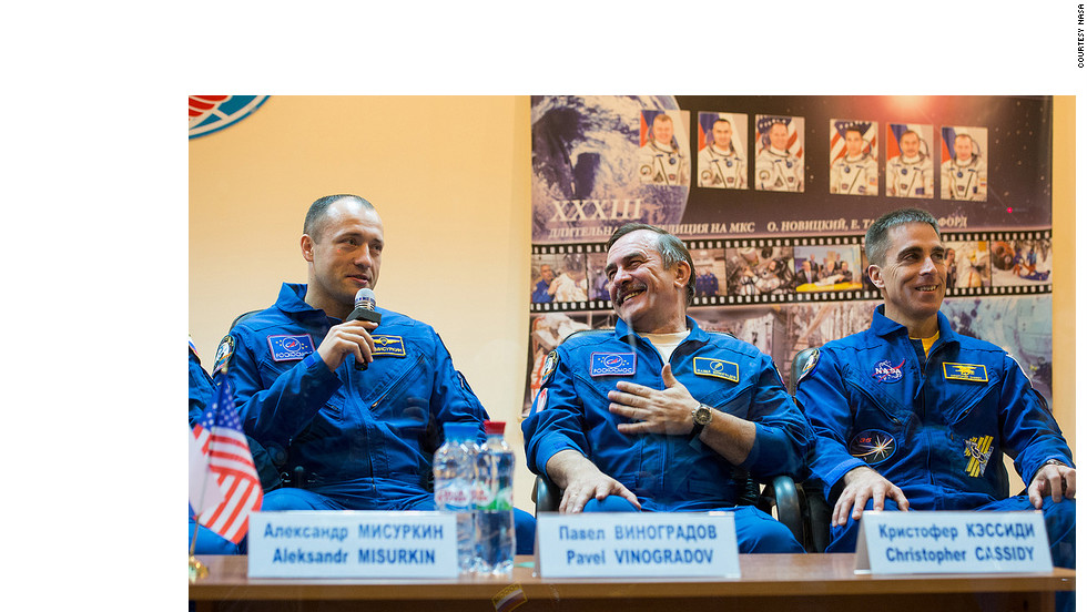 The Expedition 33 backup crew, Russian cosmonaut Alexander Misurkin, left, Russian cosmonaut Pavel Vinogradov and NASA astronaut Chris Cassidy speak at a press conference at the Cosmonaut Hotel on Monday, October 22.