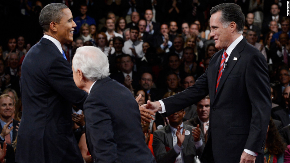 Obama and Romney greet each other as they join Schieffer on stage.