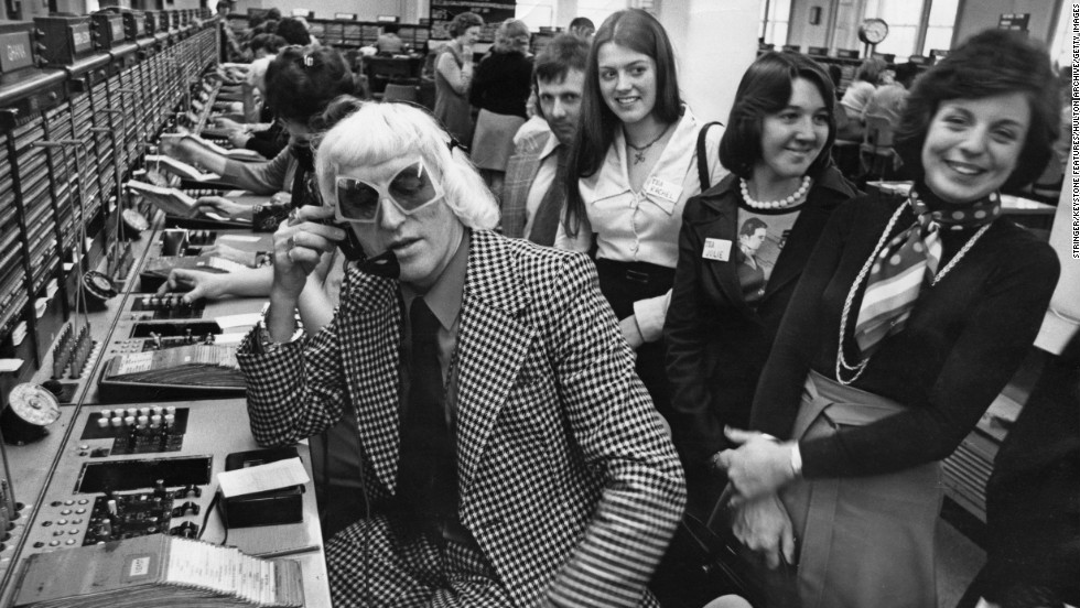 "Savile calls from the Wren House International Telephone Exchange in London in 1975 as part of a ""Fun And Happiness Weekend,"" organized by the National Association of Youth Clubs."