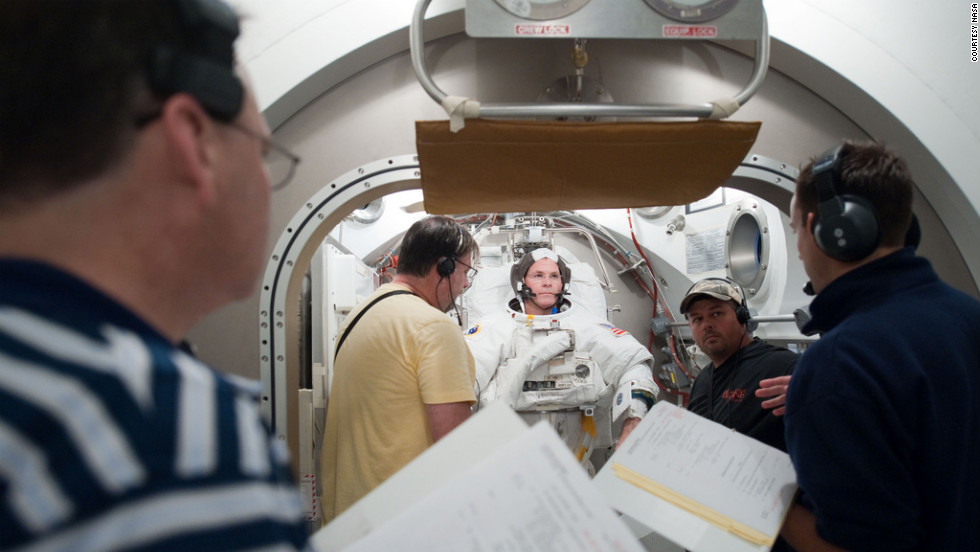 Ford has a spacesuit fit check at NASA's Johnson Space Center.