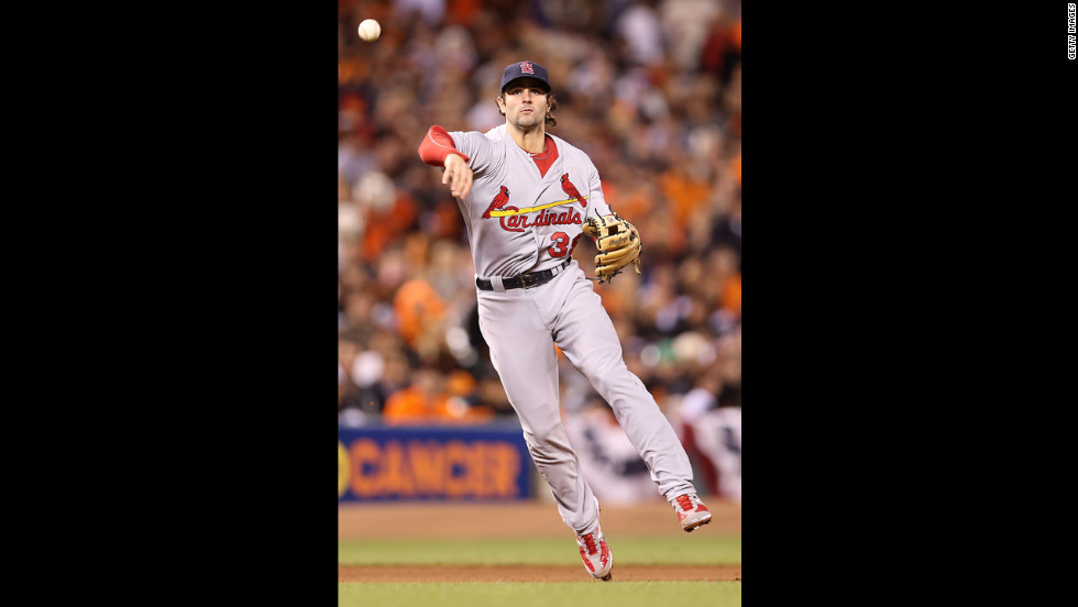 Pete Kozma of the St. Louis Cardinals throws out Buster Posey of the San Francisco Giants at first base in the fourth inning on Monday.