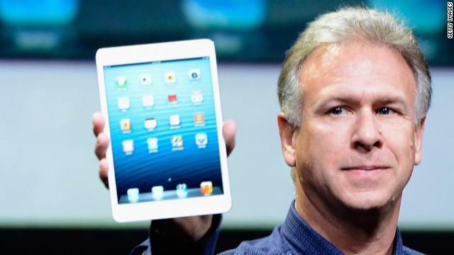 Apple marketing chief Phil Schiller holds up an iPad Mini, the company's newest gadget.