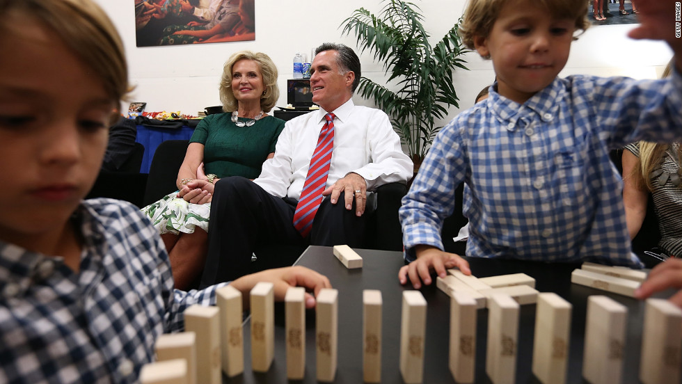 Romney and his wife, Ann, try to relax backstage with members of their family before the start of Monday's debate.
