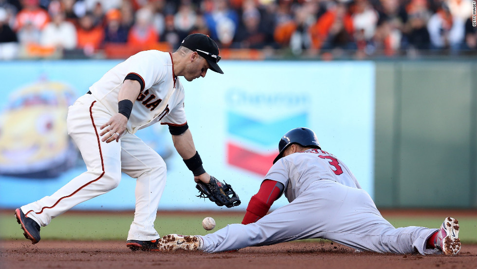 No. 3 Carlos Beltran of the Cardinals steals second base safely under a tag attempt by No. 19 Marco Scutaro of the Giants in the first inning.