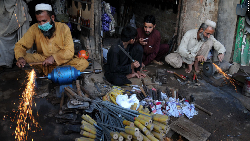 Blacksmiths sharpen various tools and knives to be used to sacrifice animals on Monday in Peshawar, Pakistan.