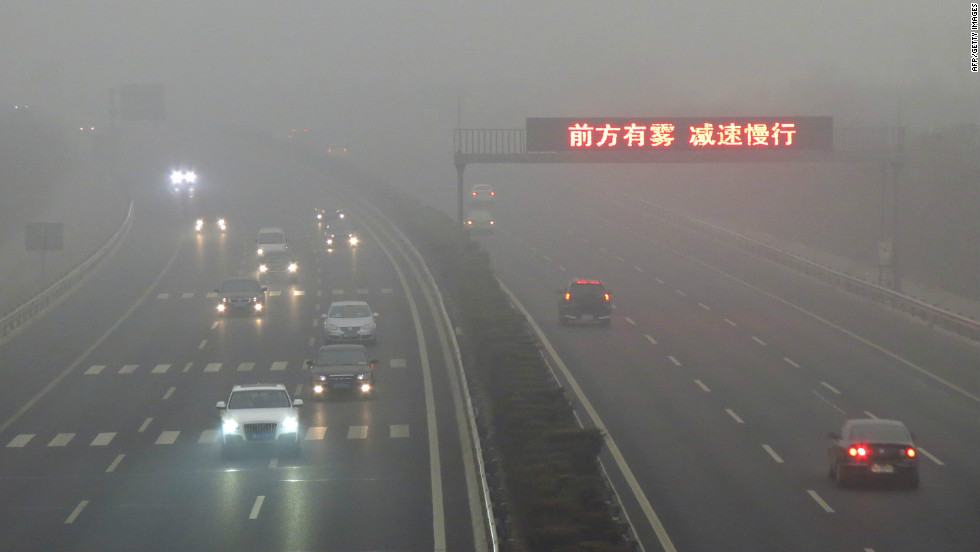 "Vehicles make their way along a highway as fog covers most of Beijing on March. Thick fog and air pollution covered the city dropping to ""hazardous"" level in early March this year."