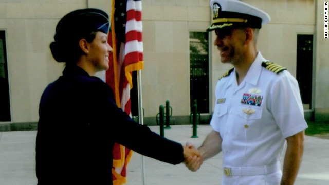 Rebecca Edmonds shakes her father's hand after her commissioning as an Air Force officer.