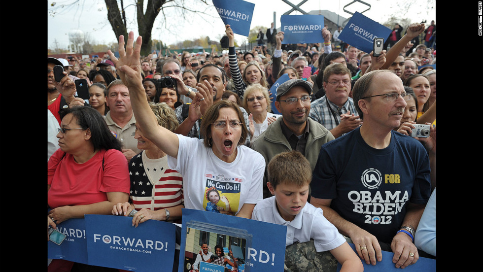 Supporters cheer as Obama speaks during a campaign event at Mississippi Valley Fairgrounds in Davenport, Iowa, Wednesday.