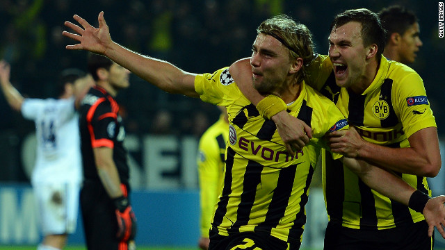Dortmund's Marcel Schmelzer celebrates his decisive goal with Kevin Grosskreutz as the Germans beat nine-time champions Real Madrid 2-1.