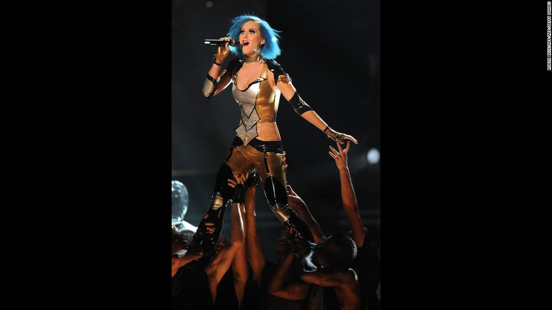 "Perry wears a body-skimming costume to perform ""Part of Me"" at the Grammys in 2012."