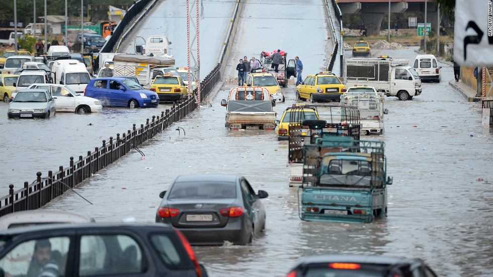 Syria drivers attempt to drive through a flooded street in Aleppo, Syria on October 25. The Syrian military and the country's main rebel force have agreed to halt combat operations starting Friday morning for the Muslim holiday weekend, but both also reserved the right to respond to attacks.