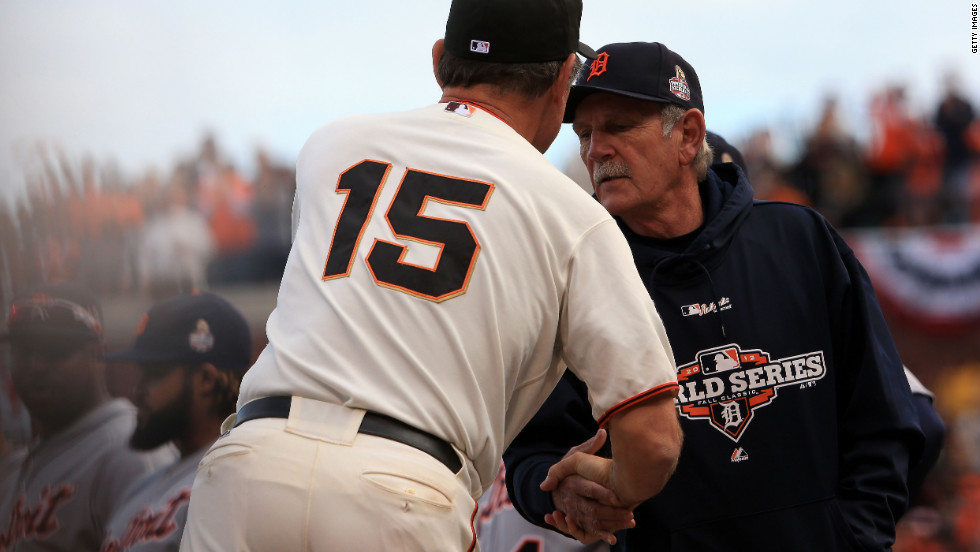 Giants manager Bruce Bochy, left, shakes hands with Tigers manager Jim Leyland in the dugout prior to Game 1.