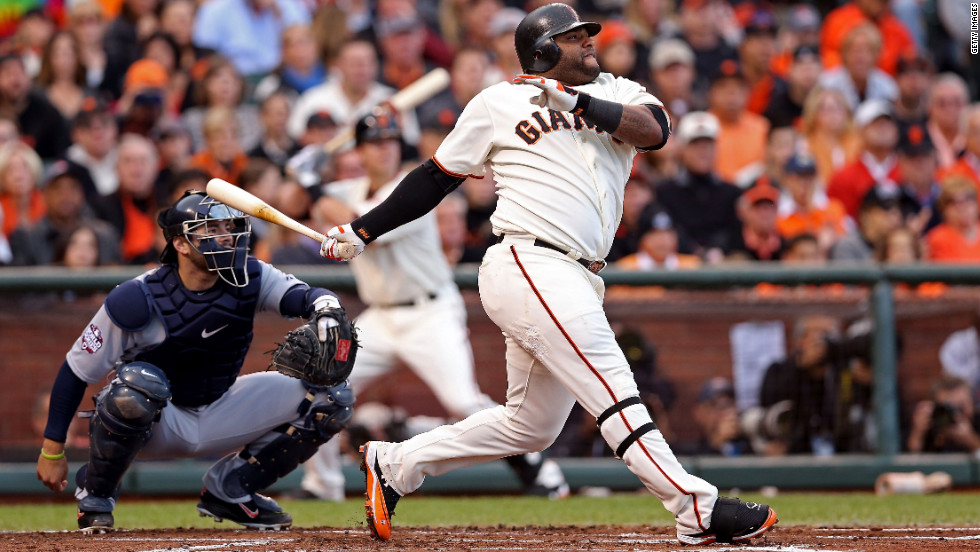 Pablo Sandoval of the San Francisco Giants hits a solo home run in the first inning of Game 1.