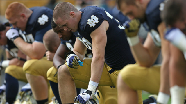 Fighting Irish players pray before last week's home game against BYU. Notre Dame defeated BYU 17-14.