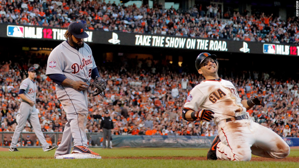 Marco Scutaro of the San Francisco Giants reacts as Prince Fielder of the Detroit Tigers makes a play for a force out at first base in the third inning of Game 2.
