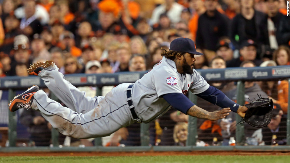 Prince Fielder of the Detroit Tigers dives for a foul ball and misses.
