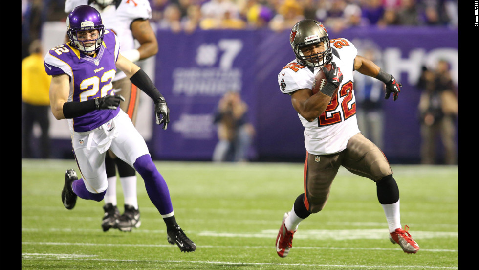 Doug Martin of the Tampa Bay Buccaneers runs up the field with Harrison Smith of the Minnesota Vikings in pursuit Thursday.