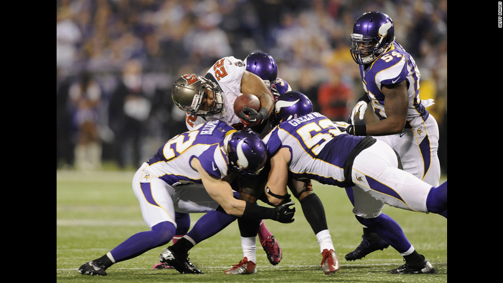Doug Martin of the Tampa Bay Buccaneers is stopped by the Vikings defense as he runs the ball on Thursday.
