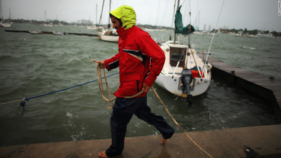 Corey Hutterli works on securing his sailboat as the outer bands of Hurricane Sandy are felt in Miami Beach, Florida, on Thursday, October 25.
