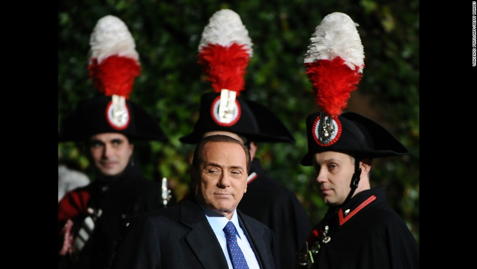 Berlusconi passes by Carabinieri guards prior a meeting with Russia's President at Villa Madama palace in Rome on February 16, 2011.