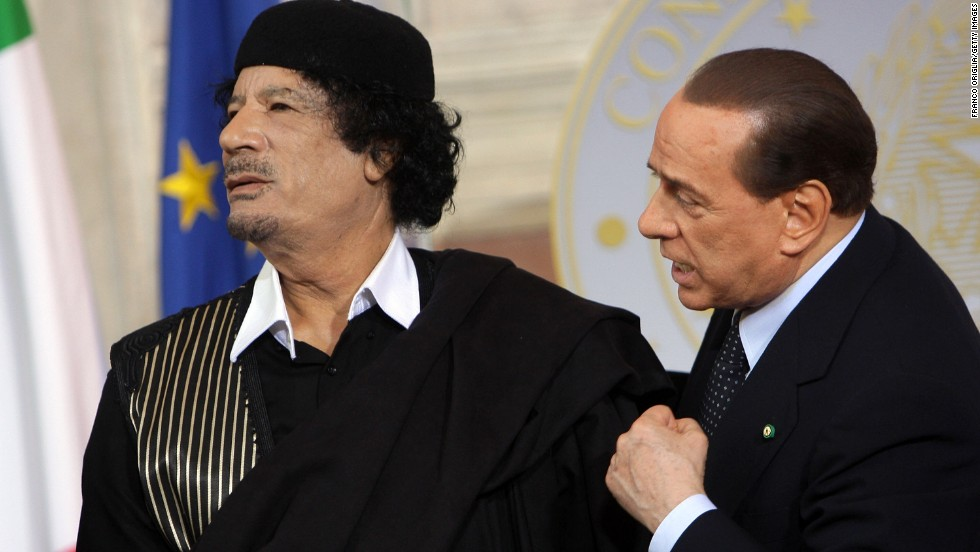 The late Moammar Gadhafi attends a meeting with Berlusconi in Rome on June 10, 2009.