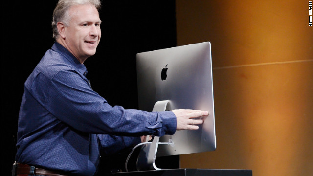 Apple marketing chief Phil Schiller shows off an ultra-thin new iMac at Apple's launch event in October.