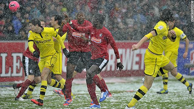 Neven Subotic (right) scores Dortmund's opening goal against Freiburg on Saturday.
