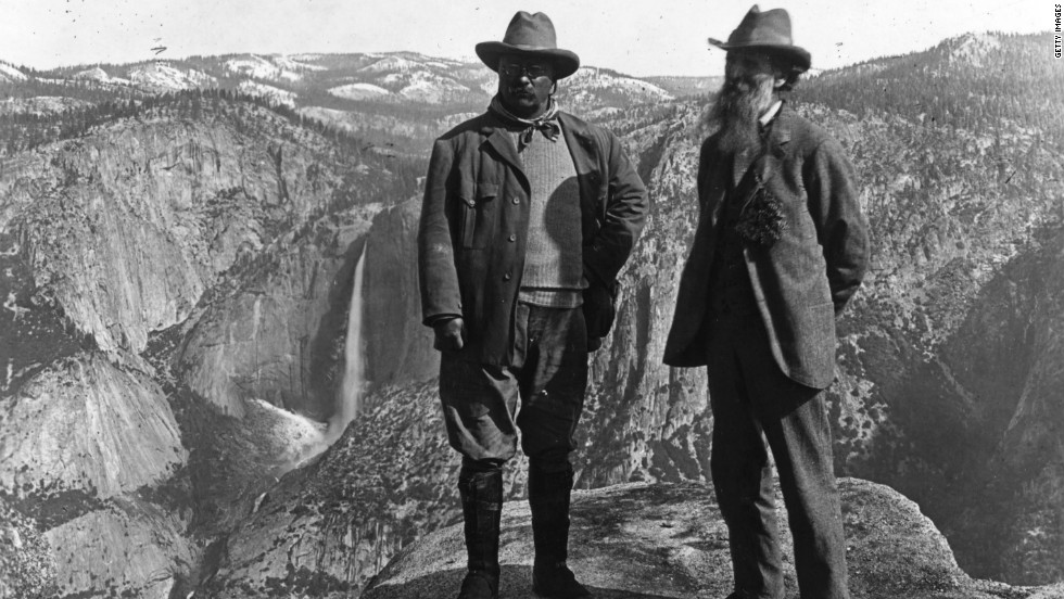 Theodore Roosevelt, left, poses with the conservationist John Muir on Glacier Point in Yosemite, California. Roosevelt was the first president to extensively preserve national forests and parks.
