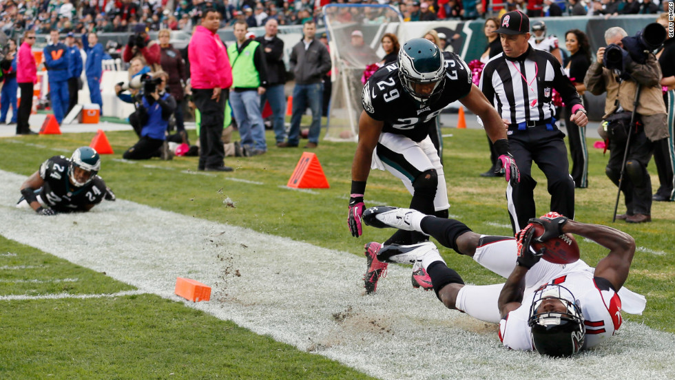 No. 24 Nnamdi Asomugha and No. 29 Nate Allen of the Philadelphia Eagles look on as Atlanta Falcons' wide receiver Julio Jones scores a touchdown during the second quarter Sunday in Philadelphia.