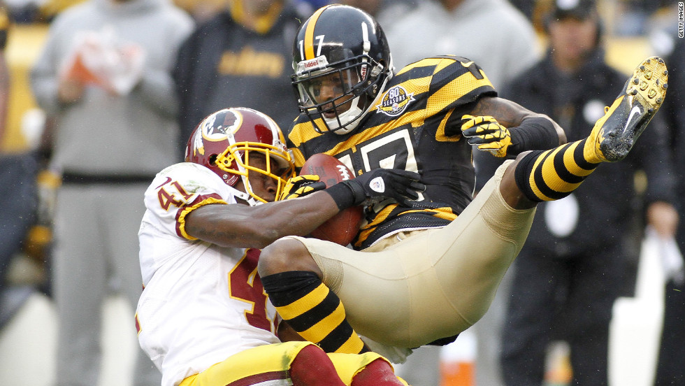 Mike Wallace of the Steelers makes a catch on Sunday and is hit by Madieu Williams of the Redskins.